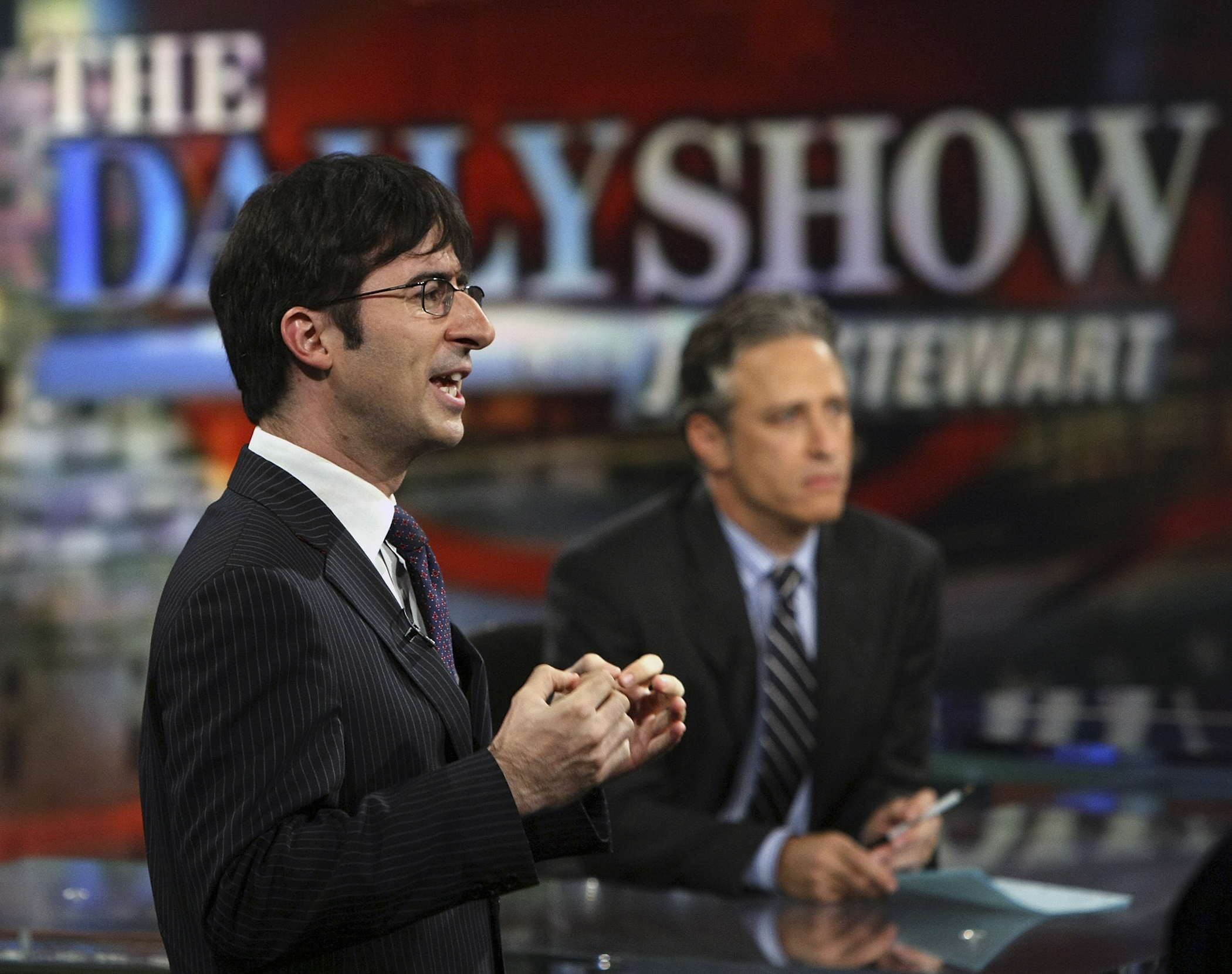 Correspondent John Oliver (L) and host Jon Stewart of Comedy Central's  The Daily Show with Jon Stewart  tape  The Daily Show with Jon Stewart: Restoring Honor & Dignity to the White House  at the McNally Smith College of Music September 3, 2008 in St. Paul, Minnesota.