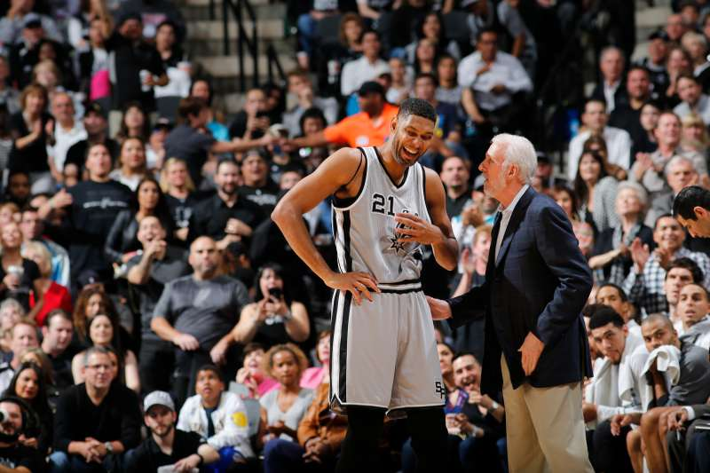 Tim Duncan of the San Antonio Spurs and coach Gregg Popovich.