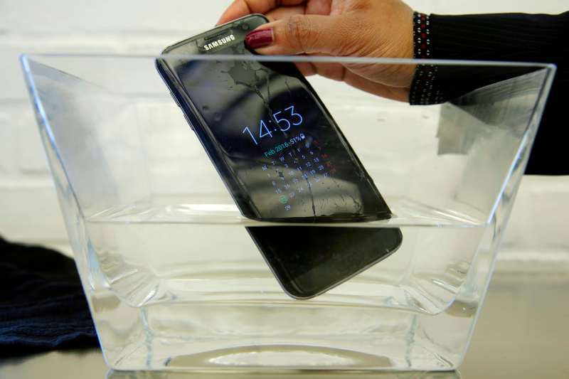 "In this Feb. 22, 2016, file photo, a waterproof Samsung Galaxy S7 Edge mobile phone is submersed in water during a preview of Samsung's flagship store, Samsung 837, in New York's Meatpacking District. Consumer Reports says Samsung's Galaxy S7 Active malfunctions in water despite being marketed as water resistant, though the regular S7 and S7 Edge models passed. Consumer Reports rates the S7 and S7 Edge phones as ""Excellent"" and the Active likely would have joined them. Instead, Consumer Reports isn't recommending the model because two phones failed after being submerged in water."