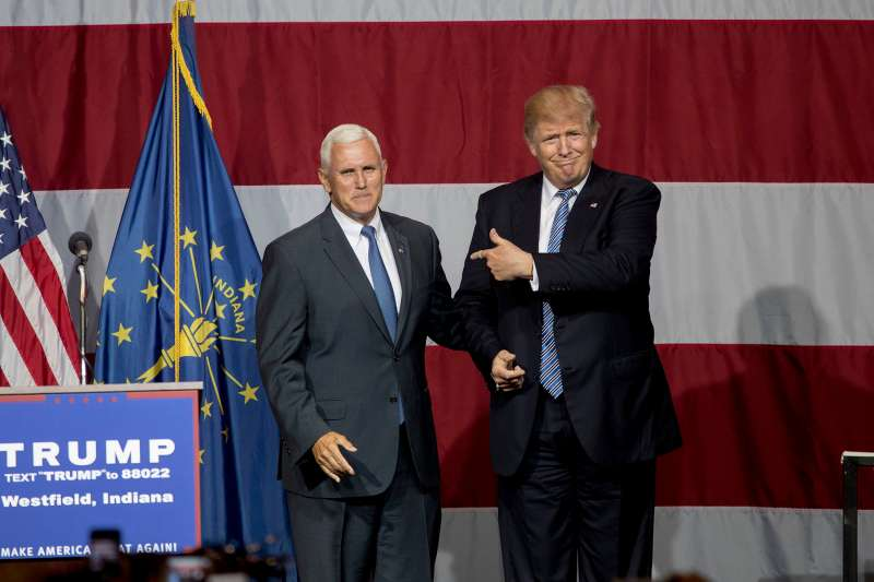 Republican presidential candidate Donald Trump greets Indiana Gov. Mike Pence at the Grand Park Events Center on July 12, 2016 in Westfield, Indiana.