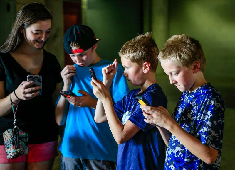 Youngsters play during a  Pokemon Go  event at Memorial Stadium in Lincoln, Neb., Thursday, July 14, 2016. Nebraska Athletic Department officials opened Memorial Stadium for two hours Thursday to accommodate  Pokemon Go  players eager to capture animated monsters at the venerated field.