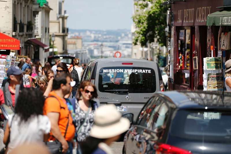 A car, part of  Operation Vigipirate , patrols in the Montmartre neighbourhood of Paris on July 15, 2016, a day after the attack in Nice. A Tunisian-born man zigzagged a truck through a crowd celebrating Bastille Day in the French city of Nice, killing at least 84 and injuring dozens of children in what President Francois Hollande on July 15 called a  terrorist  attack.