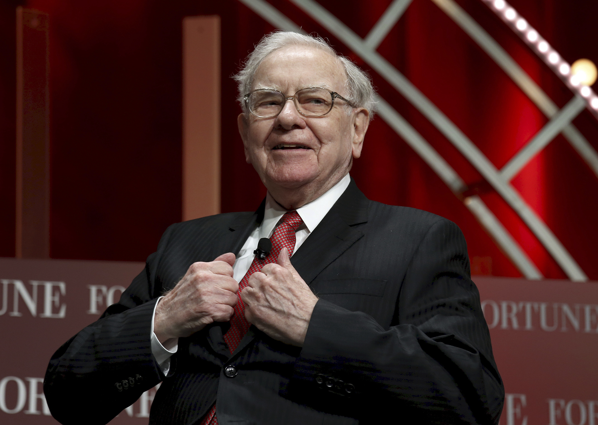 Warren Buffett, chairman and CEO of Berkshire Hathaway, takes his seat to speak at the Fortune's Most Powerful Women's Summit in Washington October 13, 2015.