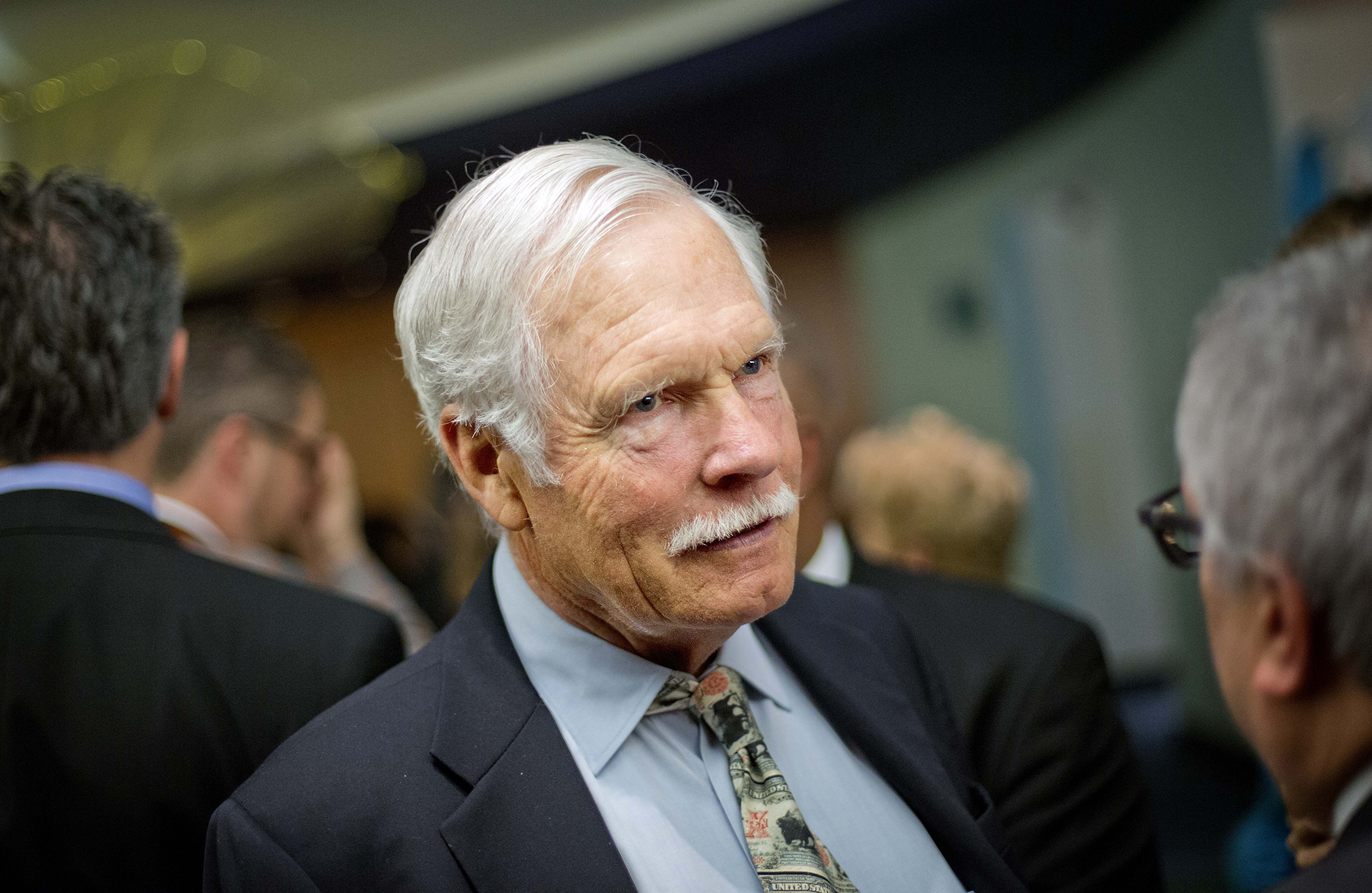 In this Friday, Dec. 6, 2013 photo, Ted Turner talks with guests at the Captain Planet Foundation benefit gala in Atlanta.