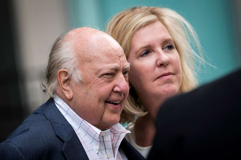 Fox News chairman Roger Ailes walks with his wife Elizabeth Tilson as they leave the News Corp building, July 19, 2016 in New York City.