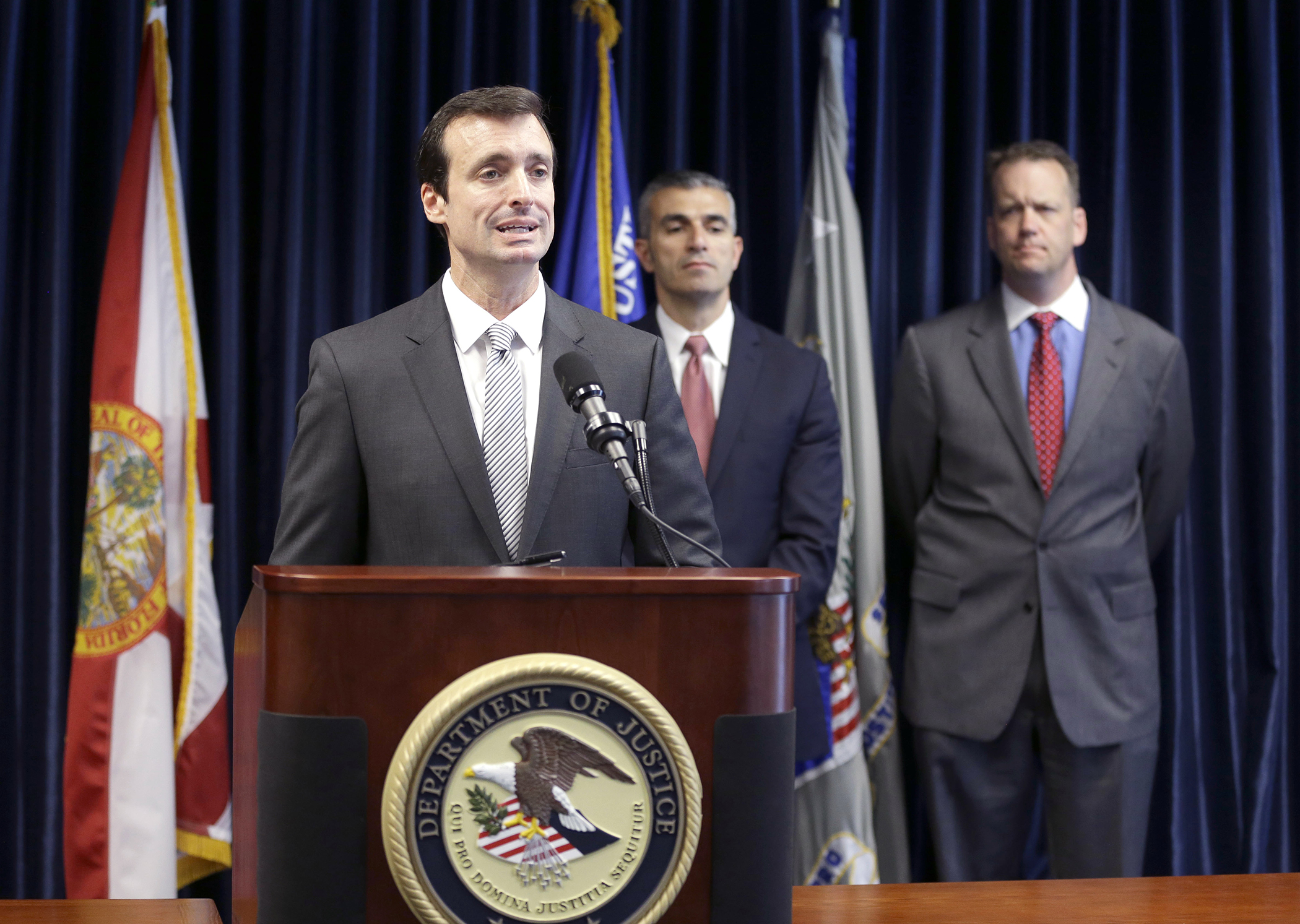 Wifredo Ferrer, left, U.S. Attorney for the Southern District of Florida, speaks during a news conference along with George Piro, center, Special Agent in Charge for the Federal Bureau of Investigation Miami and Tyler Smith, Assistant Inspector General of the U.S. Department of Health and Human Services, Office of Inspector General, Tuesday, May 13, 2014 in Miami.