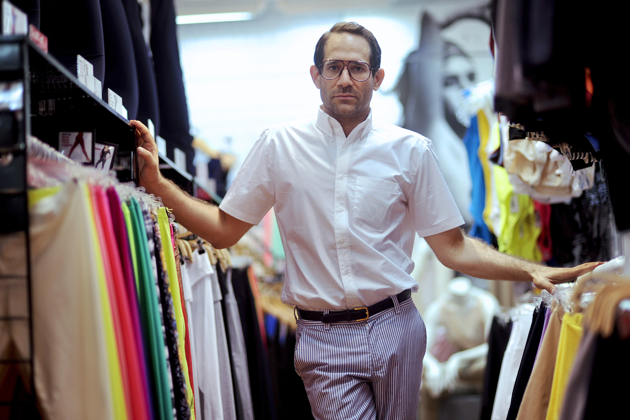 Dov Charney, chairman and chief executive officer of American Apparel Inc., stands for a portrait in a company retail store in New York, U.S., on Thursday, July 29, 2010. Starting the company in a dorm at Tufts University in Medford, Massachusetts, Charney built a worldwide empire of 280 clothing stores by leaping out ahead of mainstream fashion. He personified the racy, risk-taking aesthetics of his business and is now facing the consequences - skittish lenders and investors who doubt his ability to oversee his own creation.