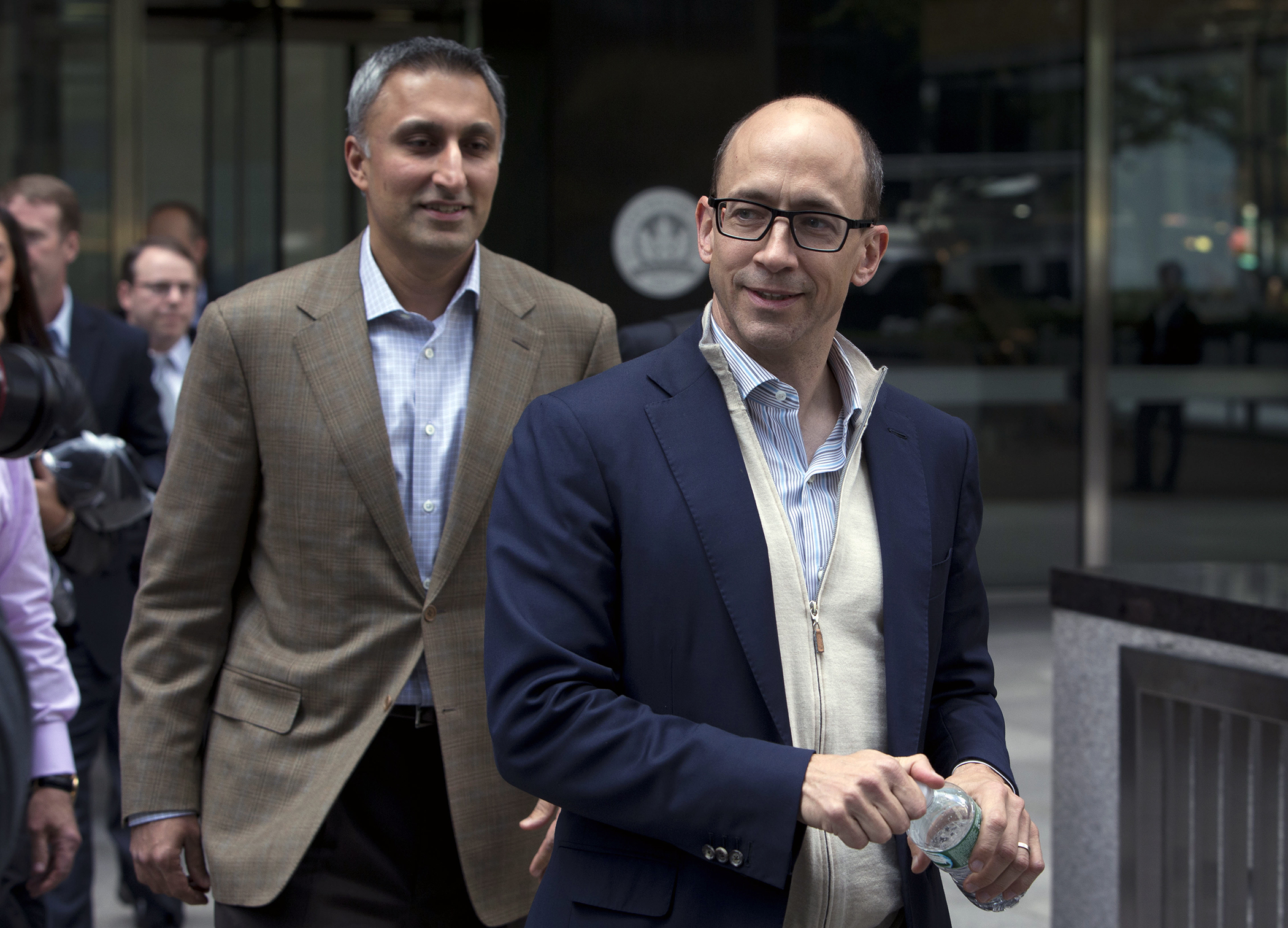 Mike Gupta, chief financial officer of Twitter Inc., left, and Richard  Dick  Costolo, chief executive officer of Twitter Inc., exit JPMorgan Chase & Co. headquarters in New York, U.S., on Friday, Oct. 25, 2013. Twitter Inc. will make the case to potential investors in its initial public offering that it needs to keep spending to grow, and profit will come once it can reap the benefits of those investments.