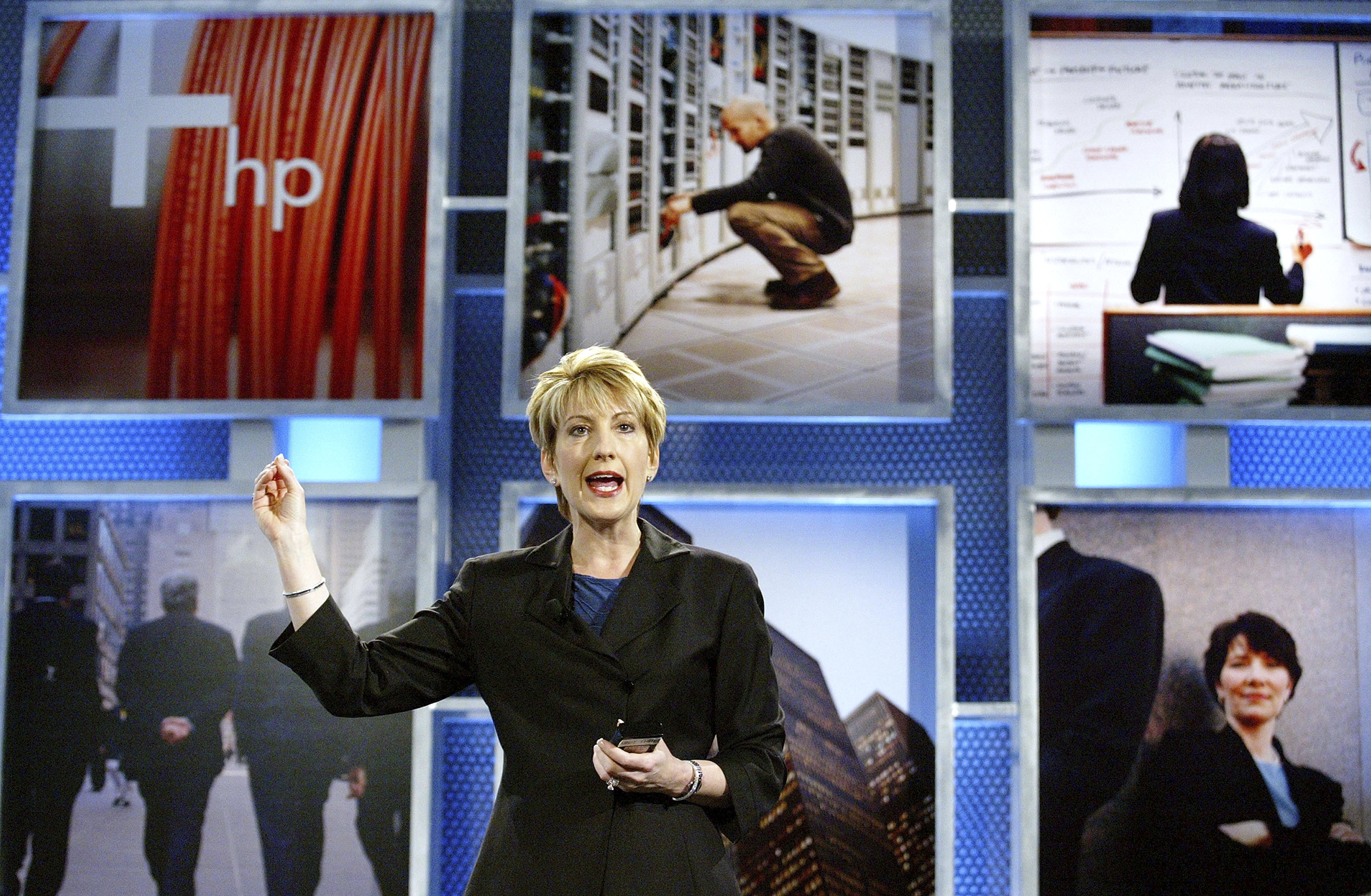 Hewlett-Packard (HP) CEO Carly Fiorina gestures as she speaks at the launch of the HP Adaptive Enterprise Strategy May 6, 2003 in San Jose, California. HP announced new products and services for companies to make their computing systems more adaptive to the changing computer world.