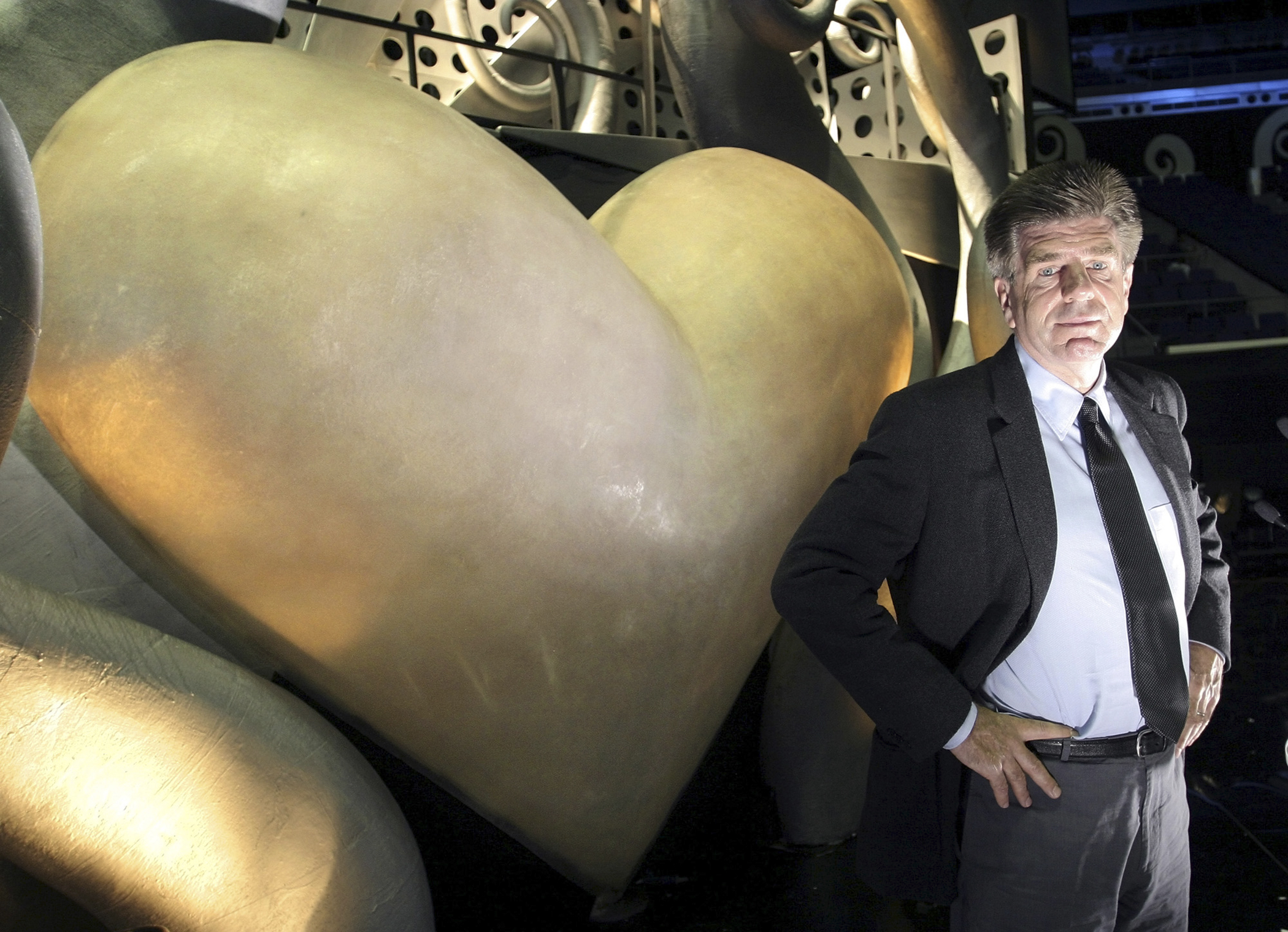 MTV Networks chairman and chief executive officer Tom Freston poses in front of a giant heart on the stage of the MTV Asia Awards in the Singapore Indoor Stadium on Friday, February 13, 2004.