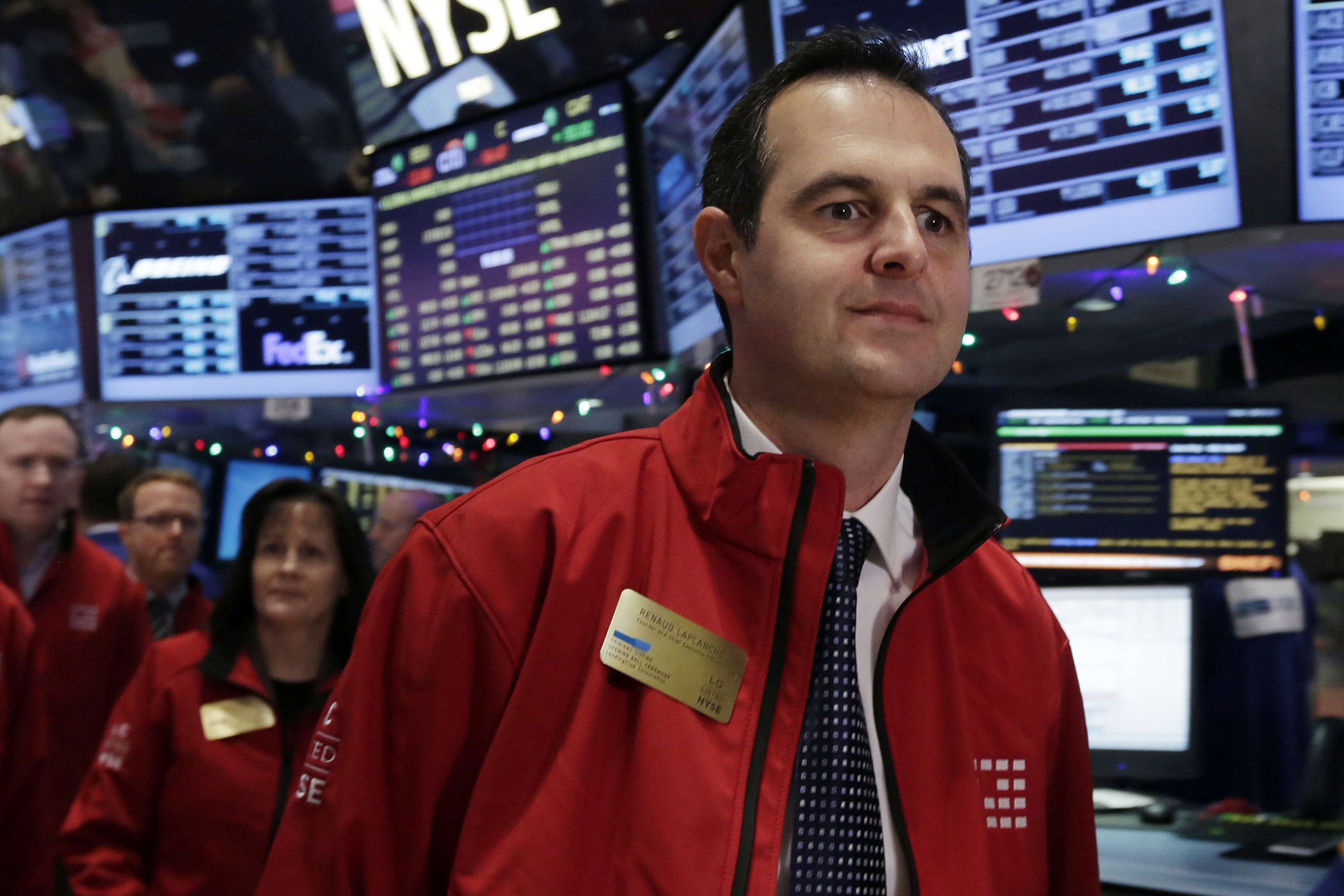 In this Dec. 11, 2014, file photo, Renaud Laplanche, founder & CEO of Lending Club, arrives on the floor of the New York Stock Exchange, prior to his company's IPO. Lending Club Chairman and CEO Laplanche is resigning after the online lender says it conducted an internal probe related to issues with how a loan was sold to an investor.