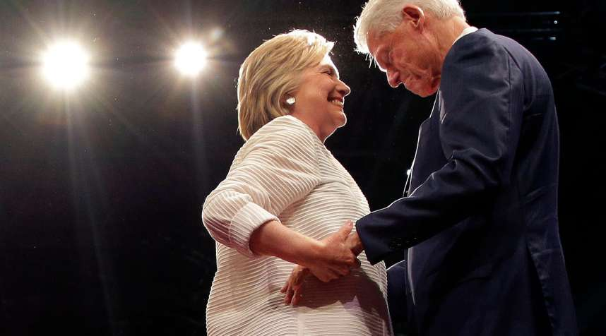 Democratic presidential candidate Hillary Clinton, second from right, greets her husband, former president Bill Clinton during a presidential primary election night rally, June 7, 2016, in New York.