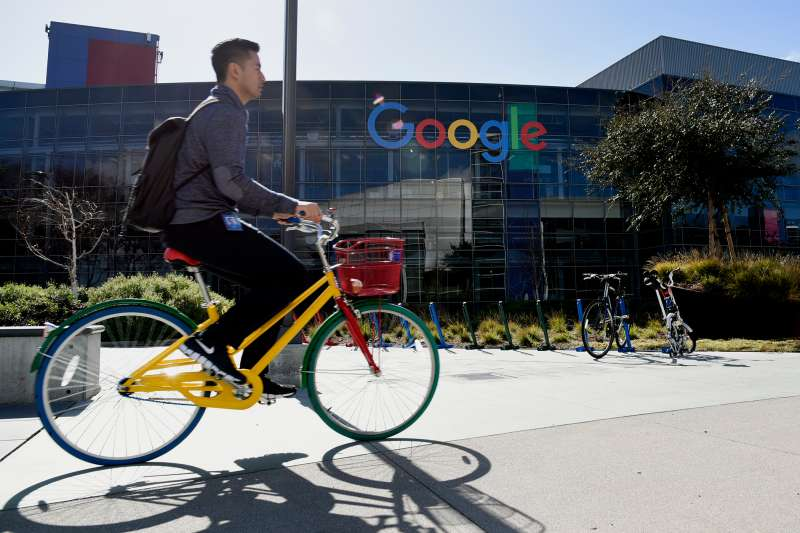 A cyclist rides past Google Inc. offices inside the Googleplex headquarters in Mountain View, California, on Feb. 18, 2016.
