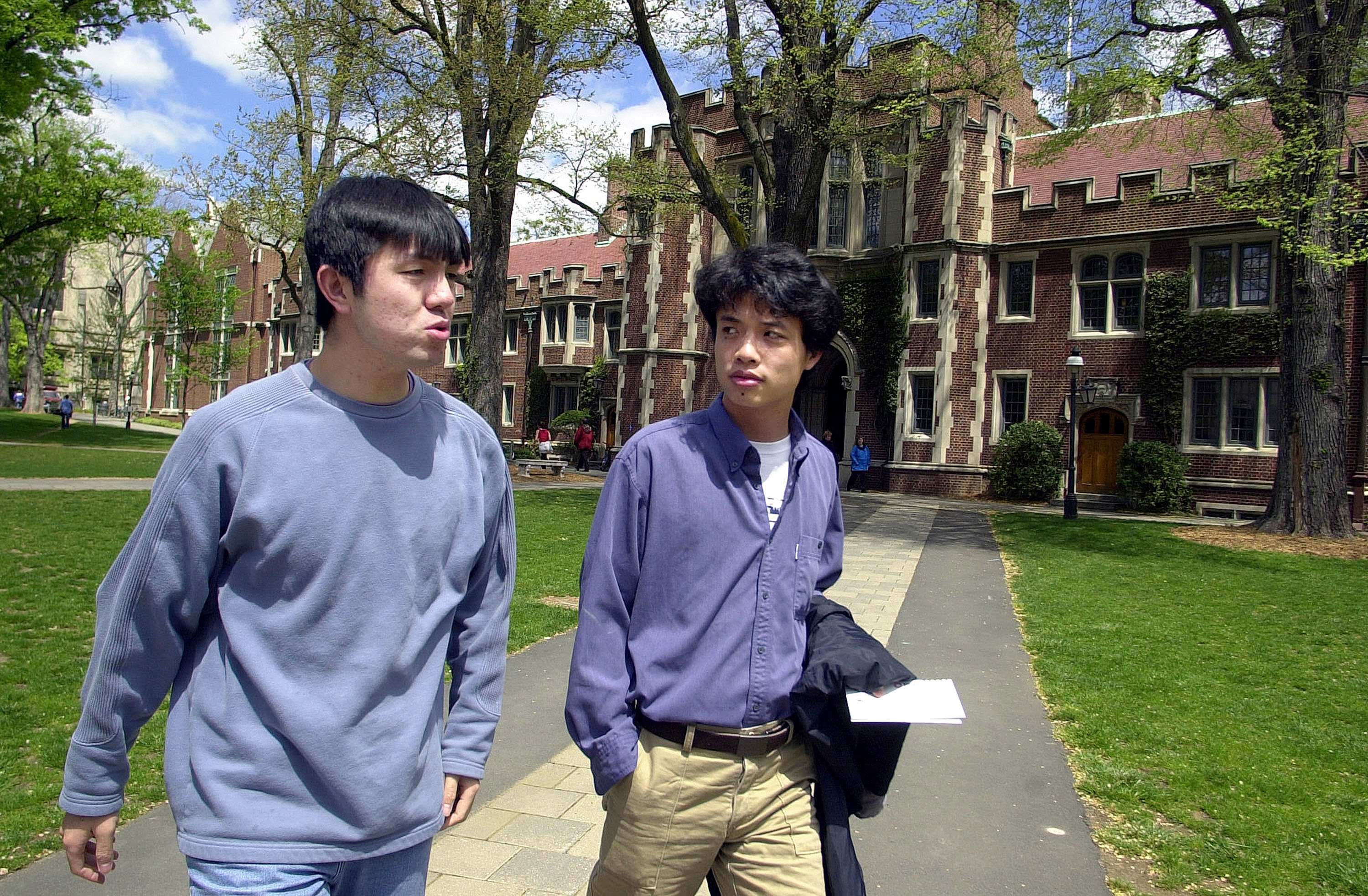 404401 06: Jian Feng Zhen (L), 23, and Dayi Deng, 23, (R), both from China, walk to class on the campus of Princeton University April 23, 2002 in Princeton, NJ. Twenty-six percent of the student population at Princeton University is an ethnic minority, according to a university spokesperson. (Photo by William Thomas Cain/Getty Images)