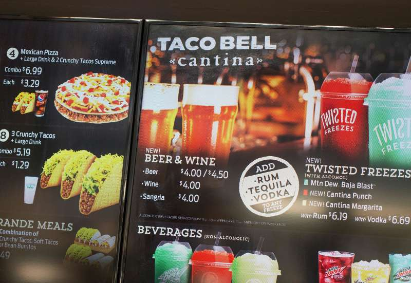 The menu at a Taco Bell Cantina restaurant lists alcoholic beverages for sale on September 22, 2015 in Chicago, Illinois. The restaurant is Taco Bell's first to serve alcohol. Along with the regular fast food menu guest can also order beer, wine, sangria and twisted Freezes which can be mixed with rum, tequila or vodka.