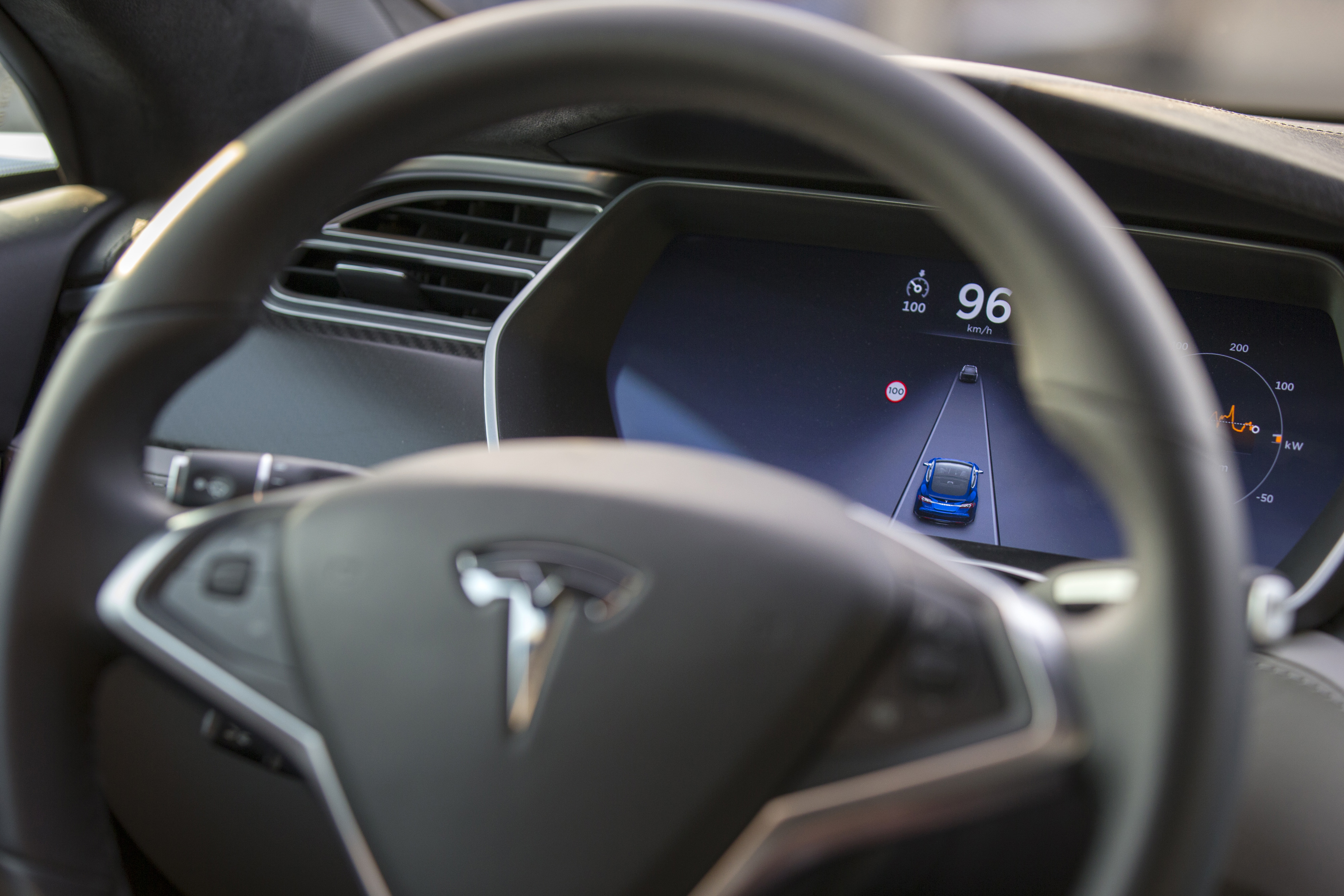 An employee drives a Tesla Motors Inc. Model S electric automobile, equipped with Autopilot hardware and software, hands-free.
