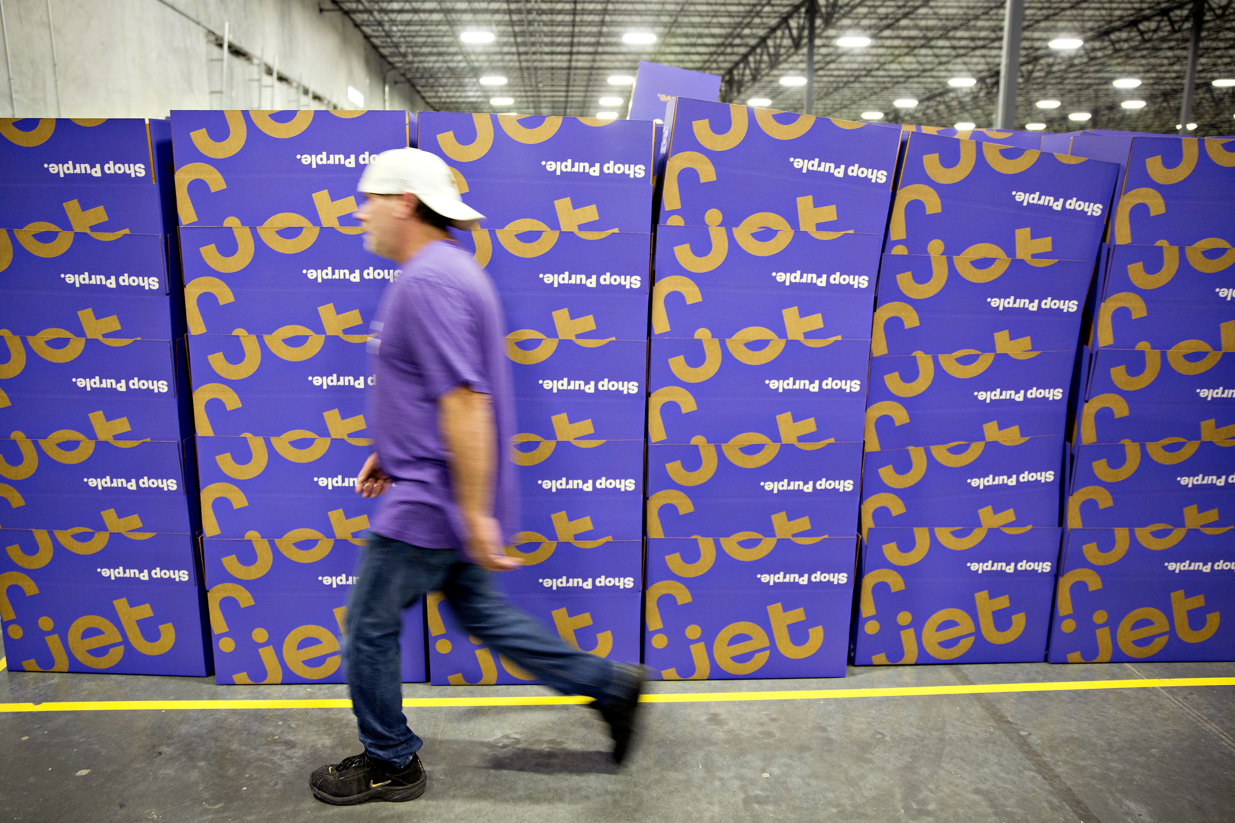 An employee walks past a stack of empty boxes at the Jet.com Inc. fulfillment center on Cyber Monday in Kansas City, Kansas, U.S., on Monday, Nov. 30, 2015. Online sales on Cyber Monday may rise at least 18 percent from a year earlier, slower growth than during the holiday weekend, as consumers start their Internet shopping earlier, according to forecasts by International Business Machines Corp. Photographer: Daniel Acker/Bloomberg via Getty Images