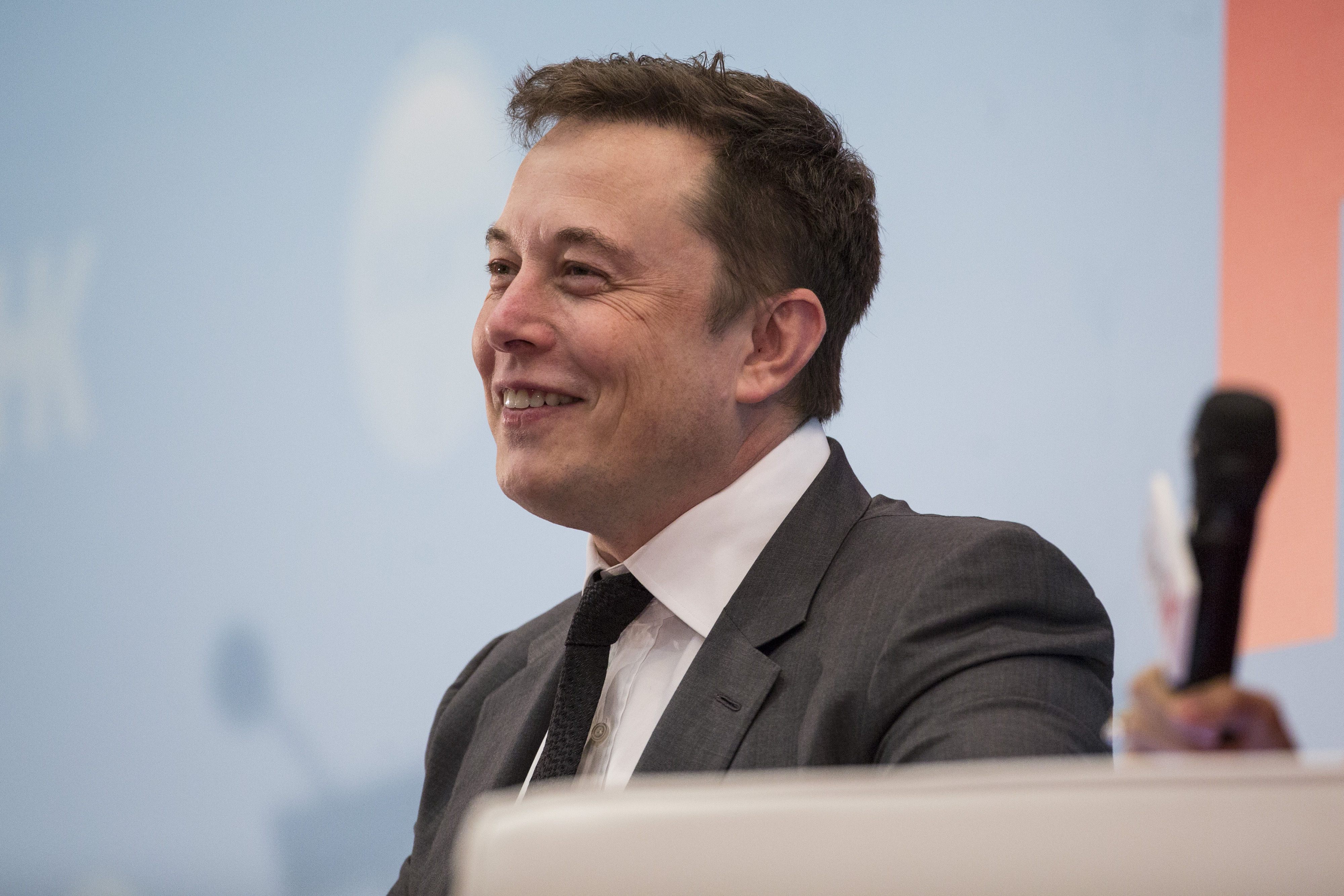 Billionaire Elon Musk, chief executive officer of Tesla Motors Inc., reacts during the StartmeupHK Venture Forum in Hong Kong, China, on Tuesday, Jan. 26, 2016. Tesla is looking for a Chinese production partner but is  still trying to figure that out,  Musk said. Photographer: Justin Chin/Bloomberg via Getty Images