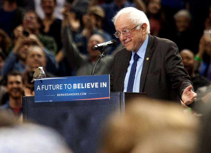 A bird lands on Democratic presidential candidate Bernie Sanders podium as he speaks on March 25, 2016 in Portland, Oregon. Sanders spoke to a crowd of more than eleven thousand about a wide range of issues, including getting big money out of politics, his plan to make public colleges and universities tuition-free, combating climate change and ensuring universal health care.Behring/Getty Images)