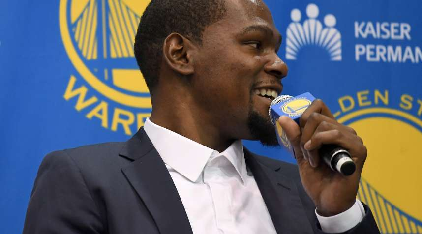 Kevin Durant speaks to the media during the press conference where he was introduced as a member of the Golden State Warriors after they signed him as a free agent on July 7, 2016 in Oakland, California.