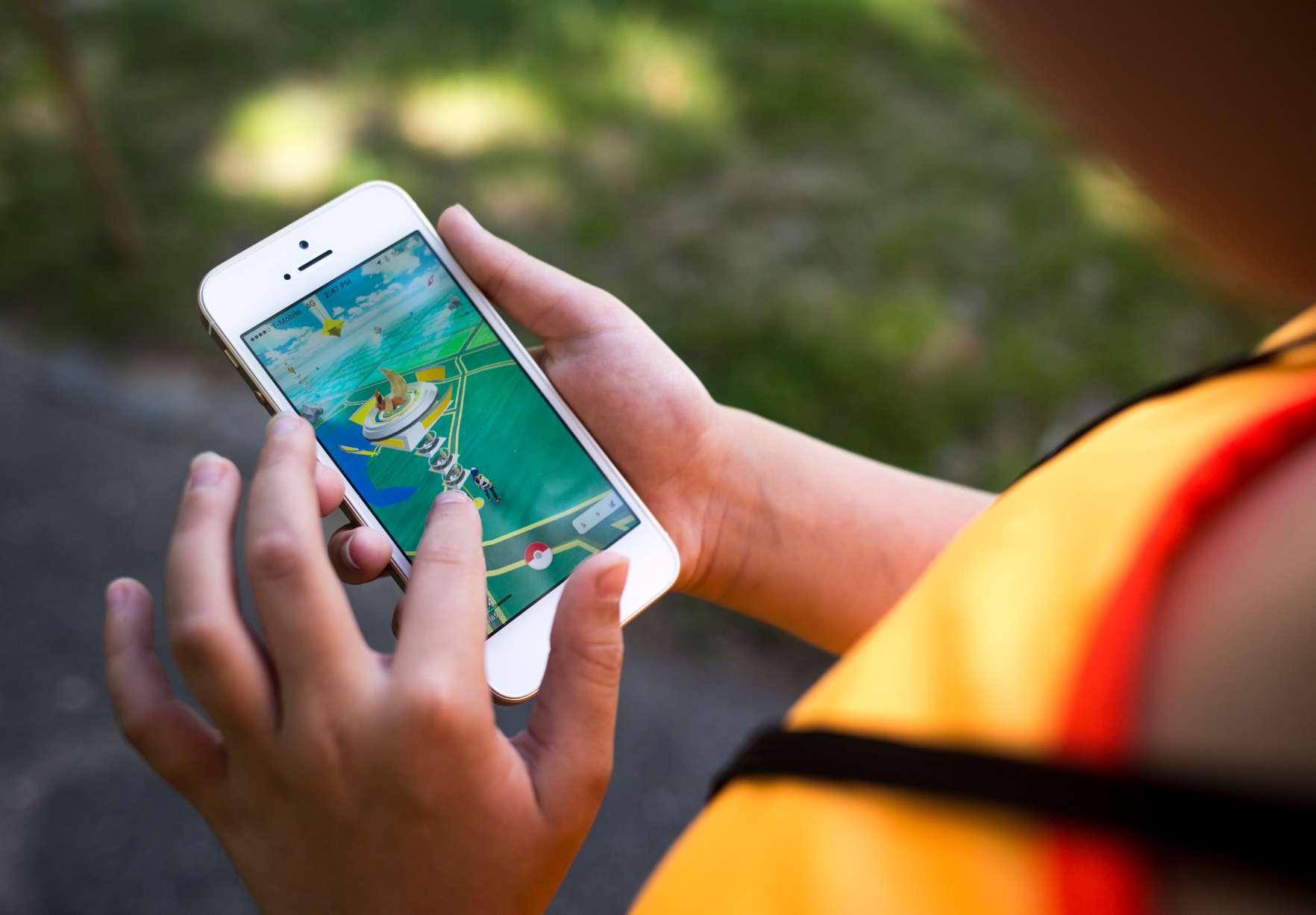 Kaelyn Kespert, 10, of Scarborough, plays Pokemon Go at Deering Oaks Park.
