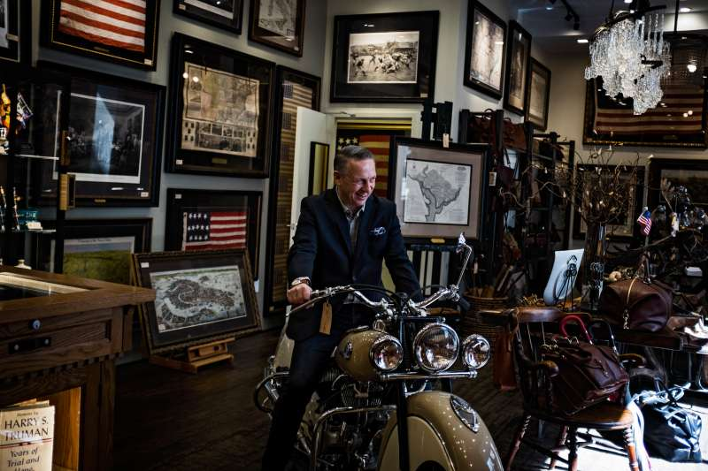 WASHINGTON, DC - MARCH 9: Eddie Papczun on a 1946 Indian Chief motorcycle in his store The Great Republic in Palmer's Alley in Washington  March 9, 2016.