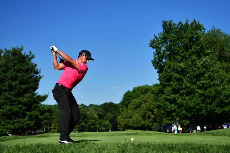 SPRINGFIELD, NJ - JULY 27: Rickie Fowler of the United States hits a tee shot during a practice round prior to the 2016 PGA Championship at Baltusrol Golf Club on July 27, 2016 in Springfield, New Jersey.