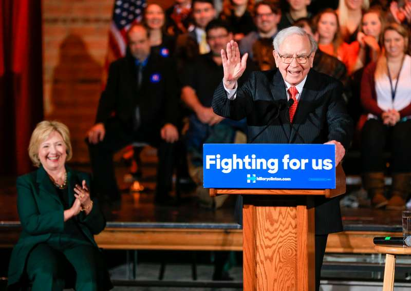 Hillary Clinton listens as billionaire investor Warren Buffett speaks at a 2015 event  in Omaha, Neb.