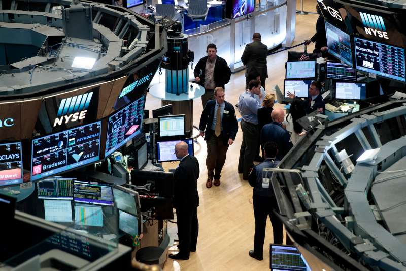 Traders and other financial professionals work on the floor of the New York Stock Exchange last month.