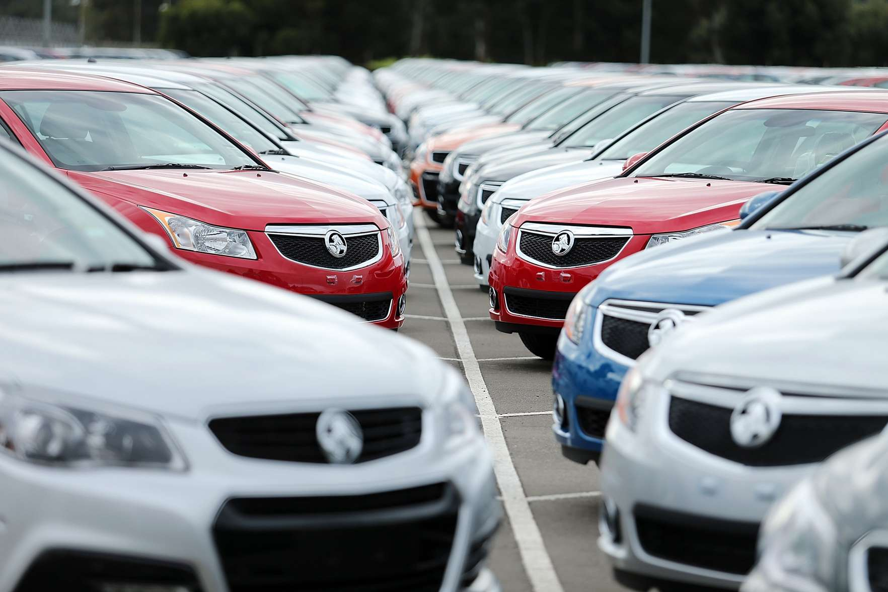 ADELAIDE, AUSTRALIA - JULY 30:  New cars are parked on the lot at the Holden manufacturing plant at Elizabeth on July 30, 2013 in Adelaide, Australia. Holden, a subsidiary of American car giant General Motors recently reduced its staff in Adelaide by 400, in an effort to reduce operating costs. Holden and other local car manufacturers have received years of both federal and state government grants, and PM Kevin Rudd recently said he was  ...determined to see this industry survive into the future.   (Photo by Morne de Klerk/Getty Images)