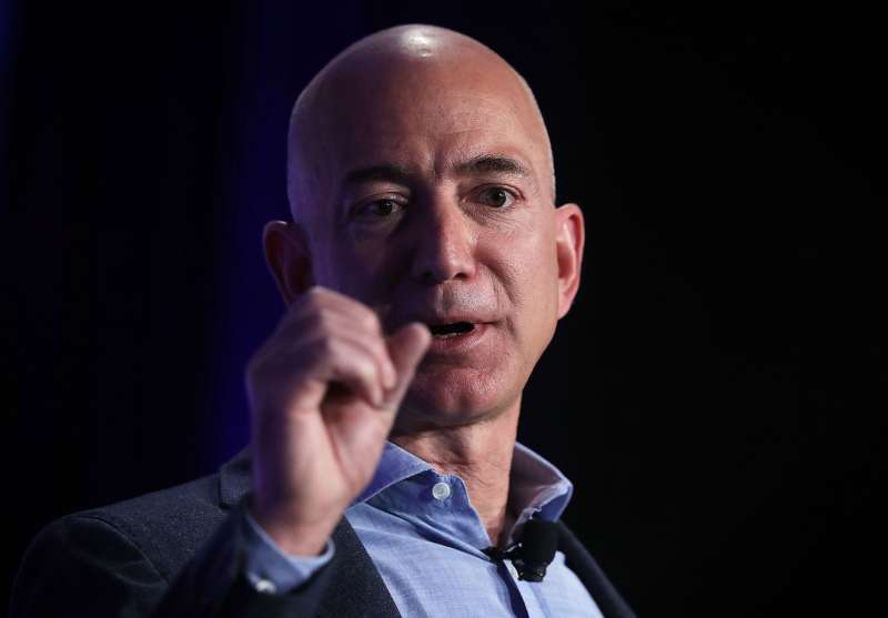 Tech stocks like Amazon, whose CEO Jeff Bezos is pictured above, are helping investors turn a profit on their portfolios.