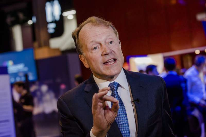John Chambers, chairman of Cisco Systems Inc., gestures whilst speaking during an interview at Viva Technology conference in Paris, France, on Thursday, June 30, 2016.