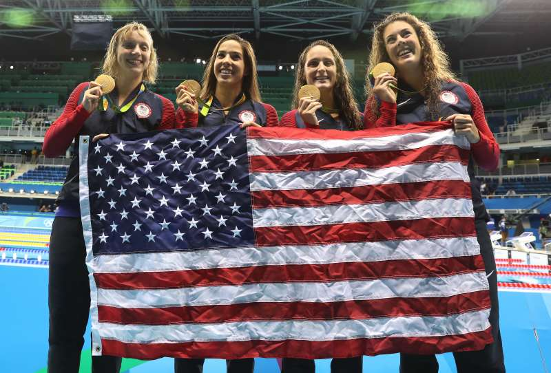 Katie Ledecky, Maya Dirado, Leah Smith and Allison Schimdt of the United States pose with their gold medals from the Women's 4 x 20m Freestyle Relay at the Rio 2016 Olympic Games at the Olympic Aquatics Stadium on August 10, 2016 in Rio de Janeiro, Brazil. (Photo by Ian MacNicol/Getty Images)