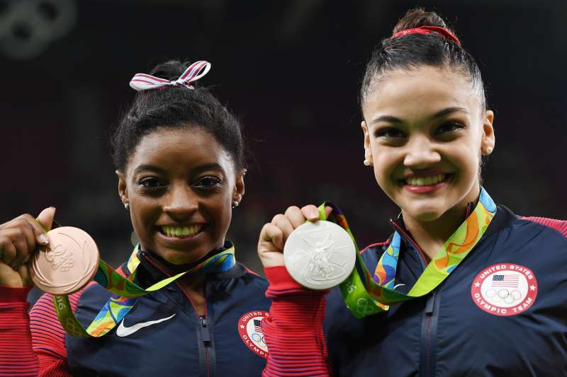 Olympic medalists like Simone Biles (left) and Lauren Hernandez (right) would be taxed on their Olympic medal bonuses under current law.