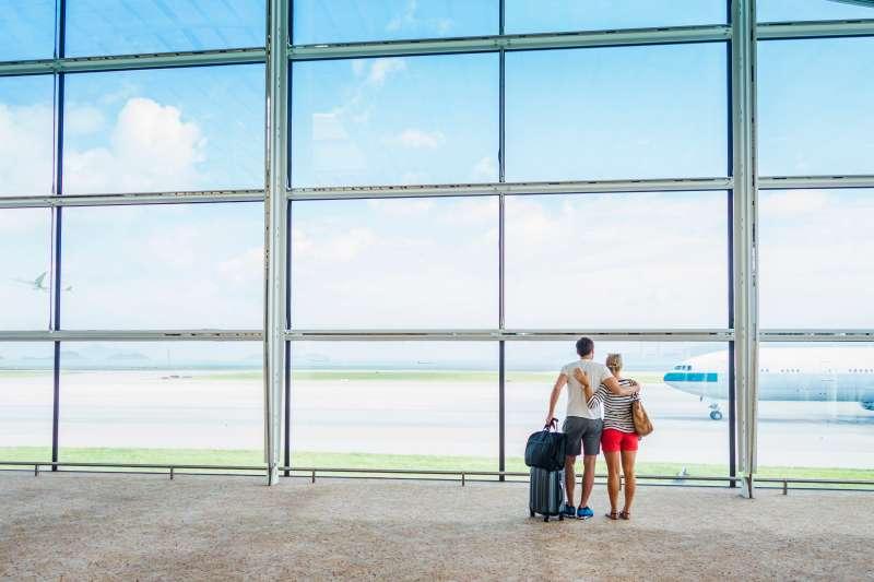 Caucasian couple hugging in airport