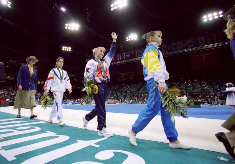 29 Jul 1996: Shannon Miller of the USA waves to the crowd as she wins the Gold medal in the Uneven Bars at the Georgia Dome in the 1996 Olympic Games in Atlanta, Georgia.