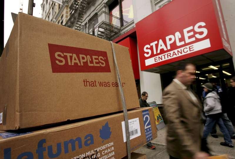 Pedestrians pass a Staples store in New York City.