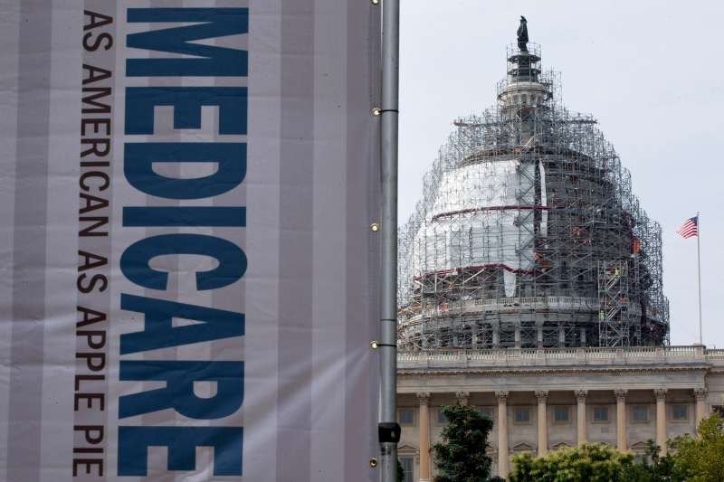 A sign supporting Medicare is seen on Capitol Hill in Washington last year.