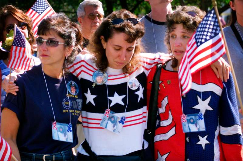 Three women embrace as they march to the  Ground Zero  site of the             World Trade Center disaster with family members and friends of victims             of the September 11, 2001 attacks on the Trade Center and the Pentagon             in New York, September 29, 2002.