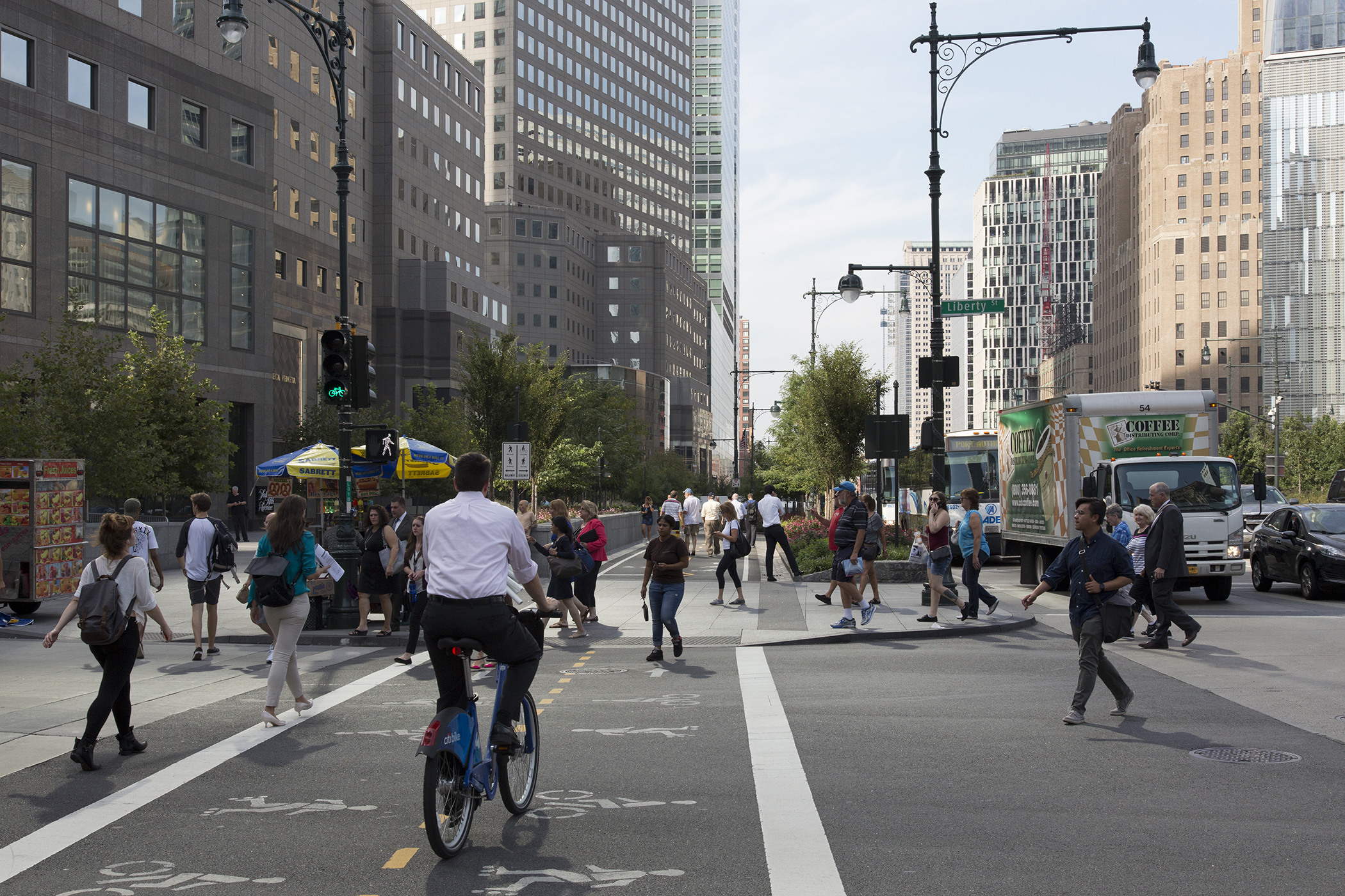 Commuters on the bustling bike path and corner of Liberty and West Streets, New York.