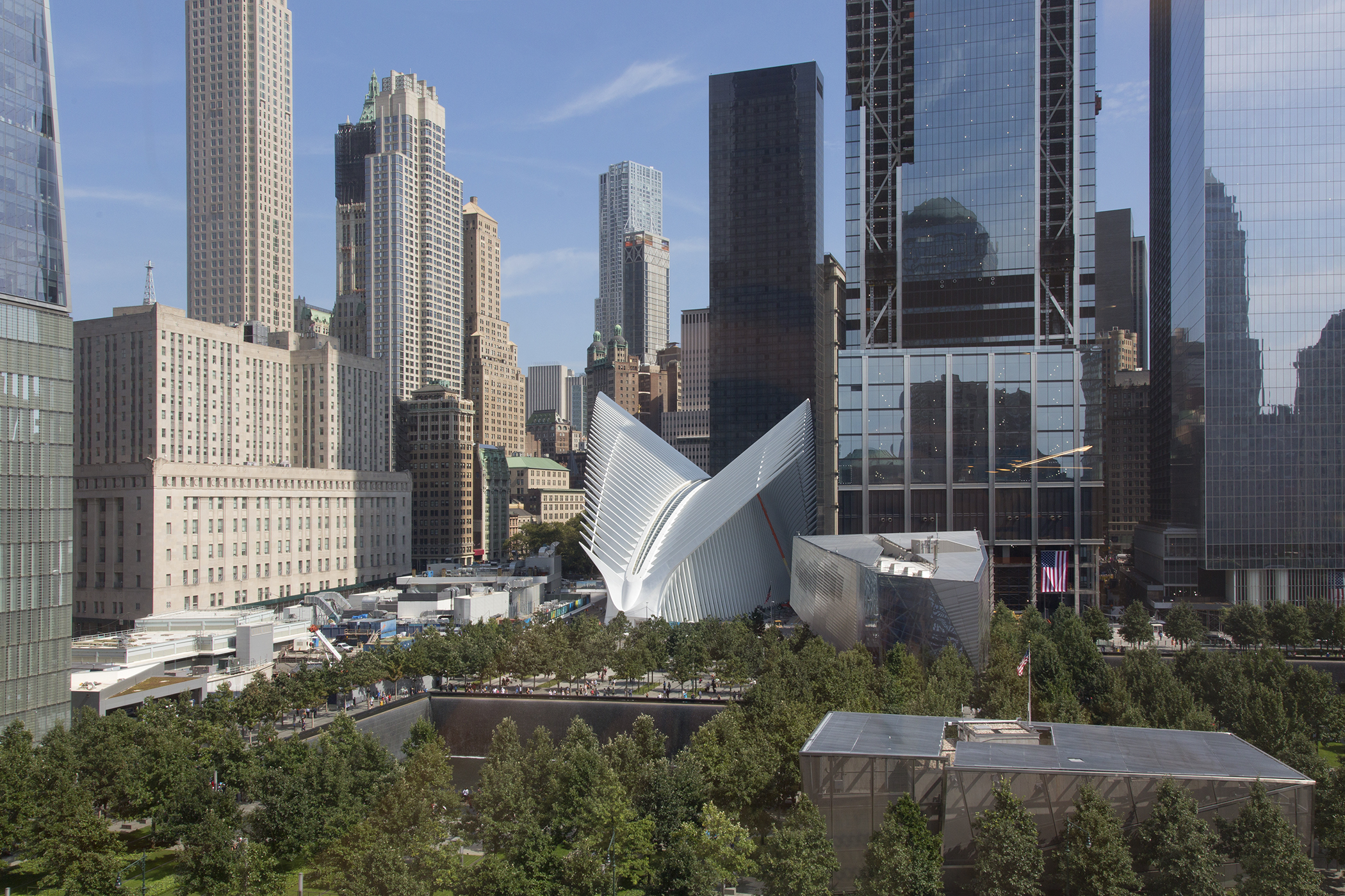 """Ground Zero"" (shown fifteen years later), with Santiago Calatrava's World Financial Center transportation hub, the September 11 Memorial and Museum and 1 WTC visible, New York, September 8, 2016."