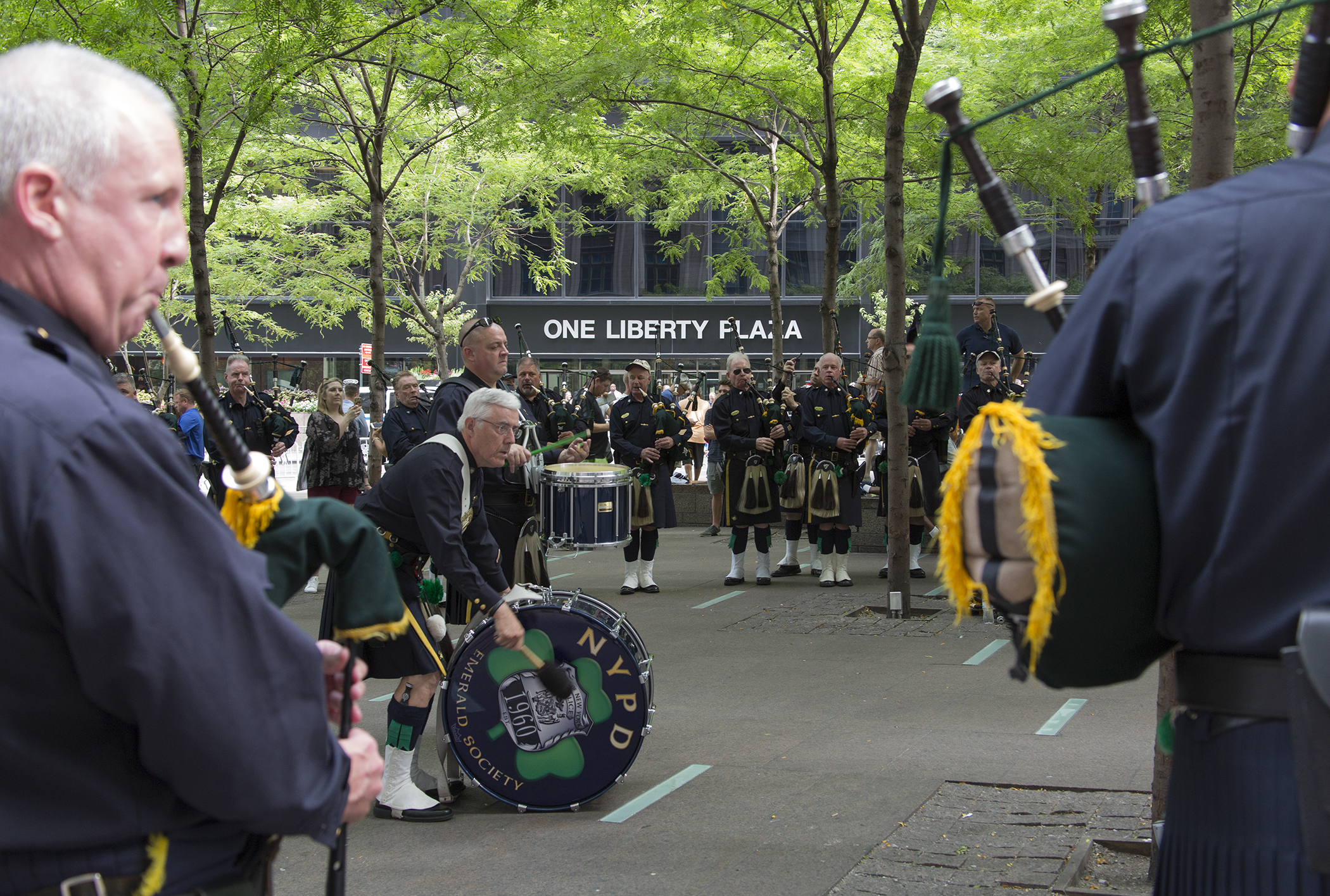 Members of NYPD Emerald Society Pipes and Drums practice in Zucotti Park, September 9, 2016.