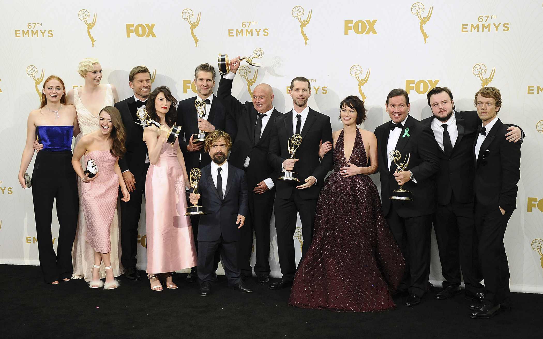 Actors Sophie Turner, Gwendoline Christie, Maisie Williams, Nikolaj Coster-Waldau, Carice van Houten, writer David Benioff, actor Peter Dinklage, Conleth Hill, writer D. B. Weiss, Lena Headey, director David Nutter and actors John Bradley-West and Alfie Allen, winners of Outstanding Drama Series for 'Game of Thrones' pose in the press room at the 67th annual Primetime Emmy Awards at Microsoft Theater on September 20, 2015 in Los Angeles, California.