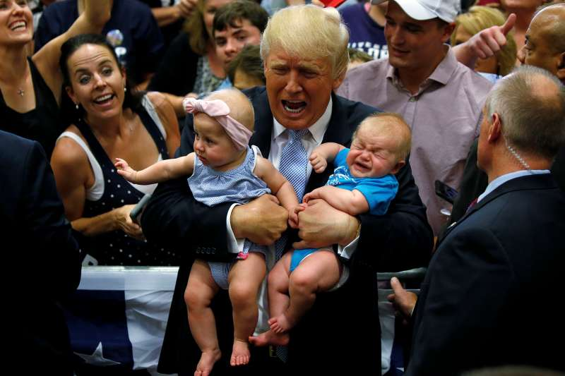 Republican presidential nominee Donald Trump holds babies at a campaign rally in Colorado Springs, Colorado, July 29, 2016.