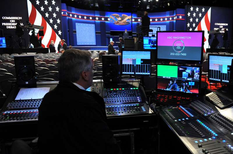 A TV technician is seen by the stage of the first presidential debate at Hofstra University's David & Mack Sport and Exhibition Complex in Hempstead, New York on September 26, 2016. The first US presidential debate, between Democratic candidate Hillary Clinton and Republican Donald Trump, is one of the high points of the campaign, six weeks from the November 8 elections.
