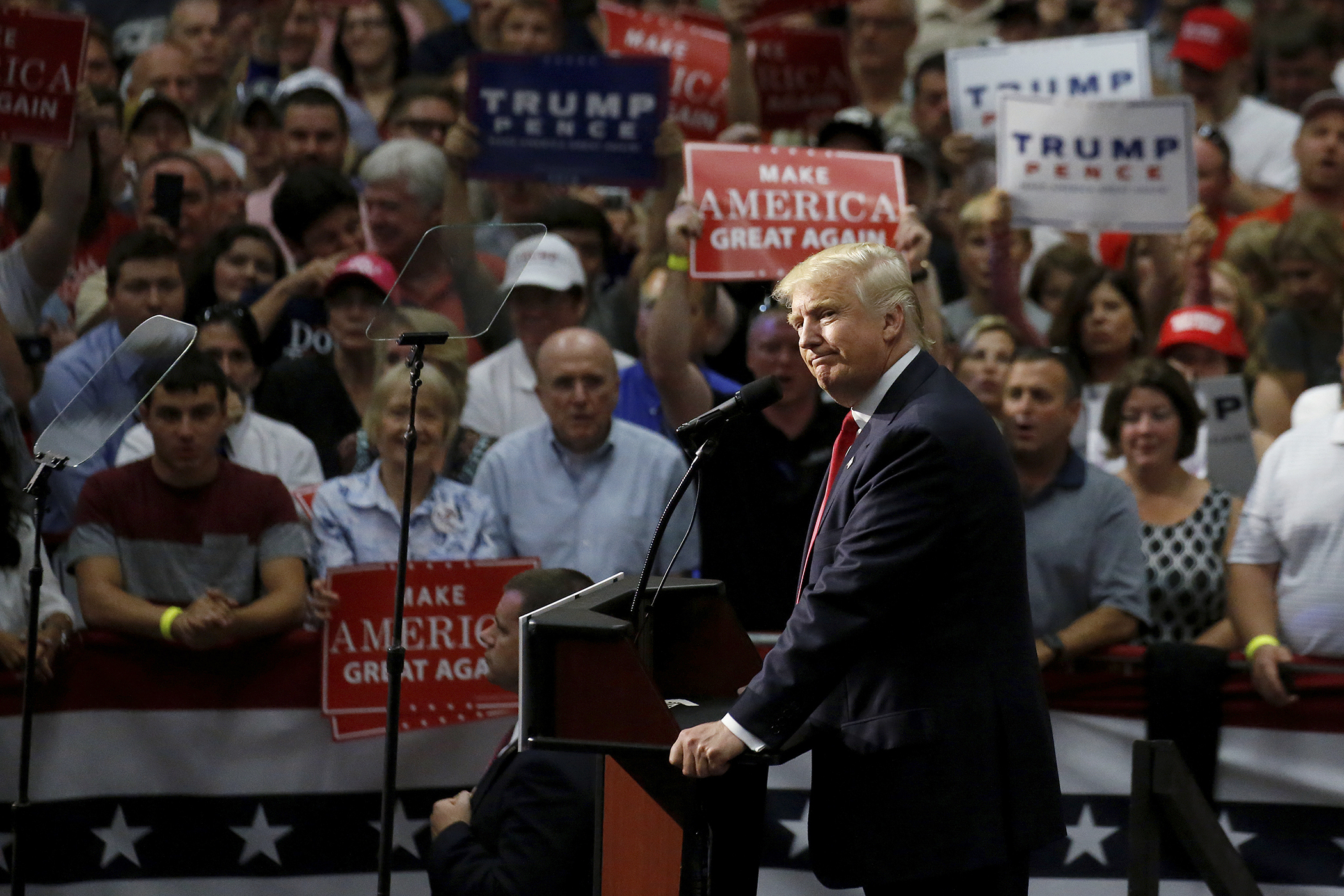 Republican presidential nominee Donald Trump speaks onstage during a campaign rally in Akron, Ohio, August 22, 2016.
