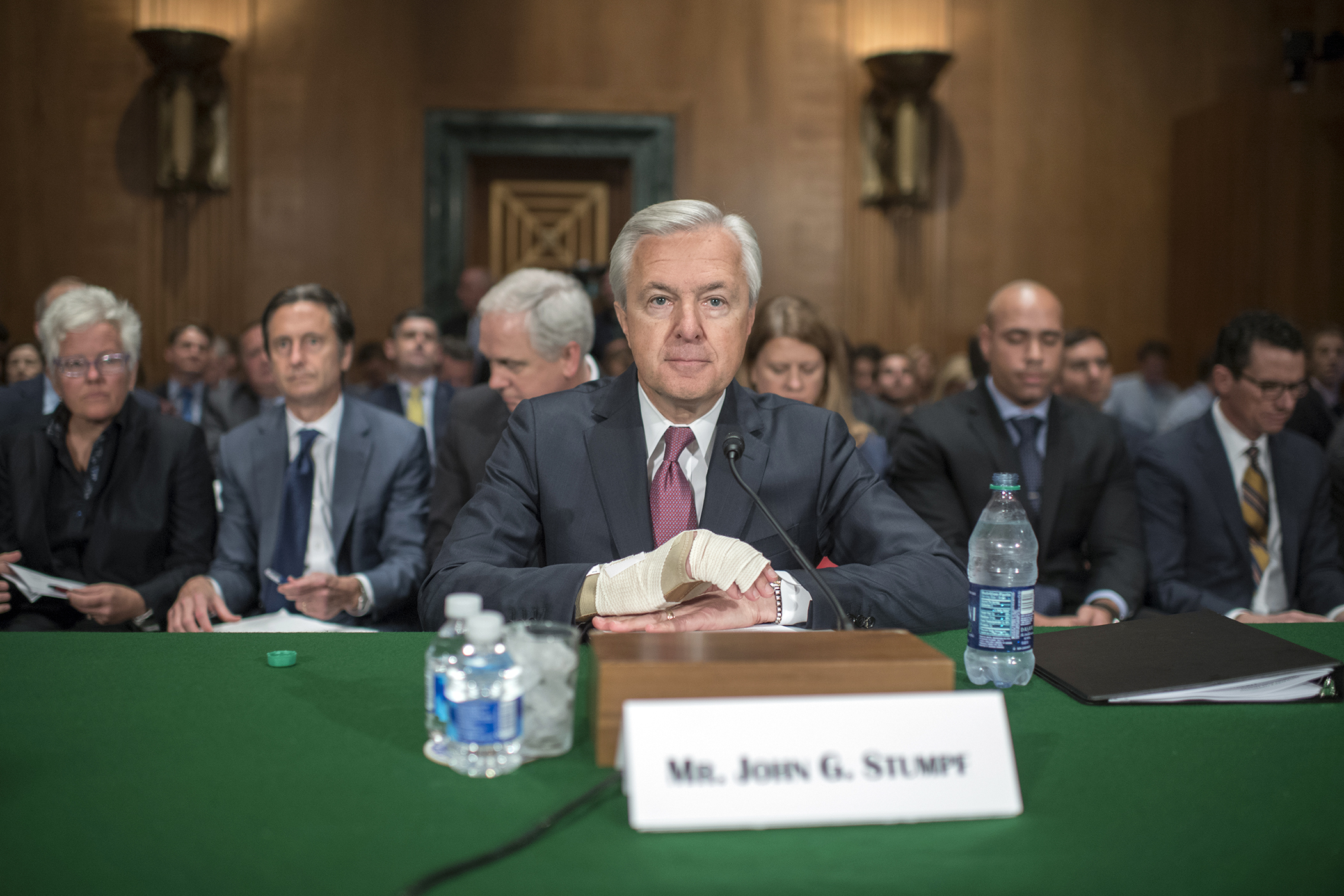 Wells Fargo CEO John Stumpf, center, prepares to testify at a Senate Banking, Housing, and Urban Affairs hearing in Dirksen Building, September 20, 2016, on the company's unauthorized accounts opened under customers' names.