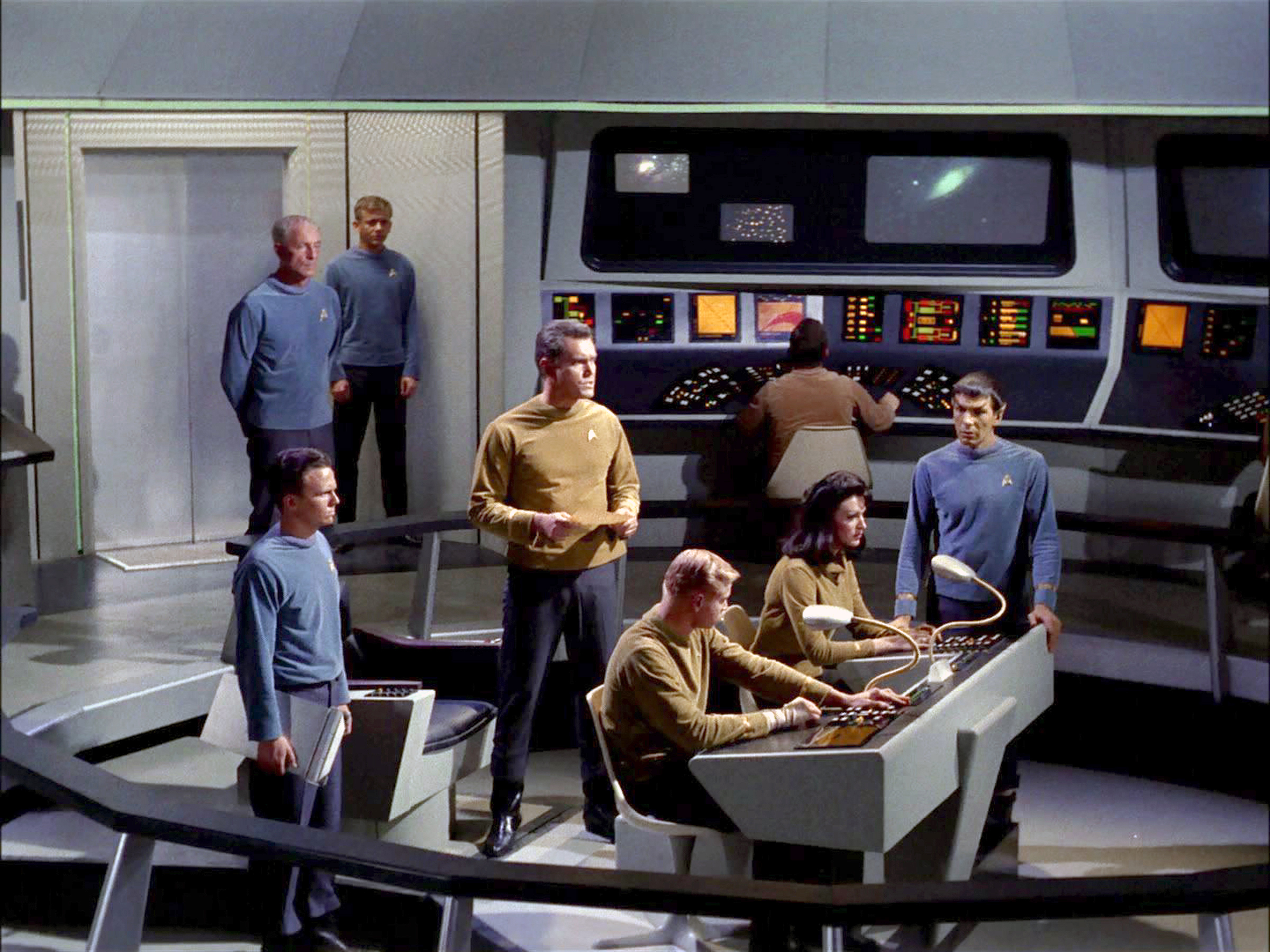 LOS ANGELES - DECEMBER 1: The crew on the bridge of the USS Enterprise.  John Hoyt as Dr. Phillip Boyce standing in back with hands behind his back, Jeffrey Hunter as Captain Christopher Pike, center holding paper, Peter Duryea as Lieutenant Jos? Tyler, seated left, Majel Barrett as Number One (M. Leigh Hudec)seated right and Leonard Nimoy as Commander Spock (Mr. Spock) standing left. in the STAR TREK: The Original Series episode,  The Cage.  This is the pilot episode completed early 1965, but not broadcast until October 4, 1988.   Image is a screen grab. (Photo by CBS via Getty Images)