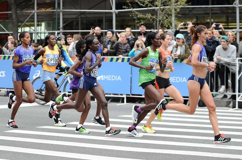 Elite female participants run through the streets of Manhattan during the TCS New York City Marathon on November 1, 2015 in New York City.