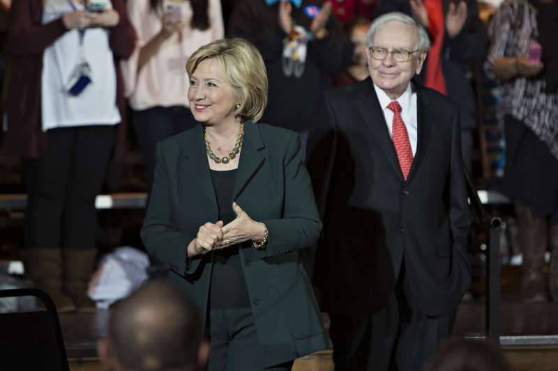 Warren Buffett, chairman and chief executive officer of Berkshire Hathaway Inc., right, looks on as Hillary Clinton, former Secretary of State and 2016 Democratic presidential candidate, smiles during an event at the Sokol Auditorium in Omaha, Nebraska, U.S., on Wednesday, Dec. 16, 2015.